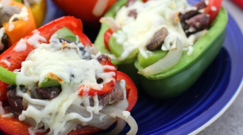 finished stuffed peppers on a bright blue plate.