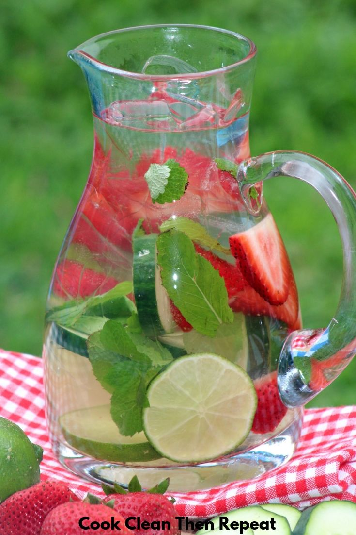 top of an image of a pitcher of water with fruit and herbs inside.