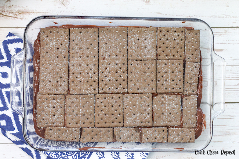 middle layer of graham crackers being added.