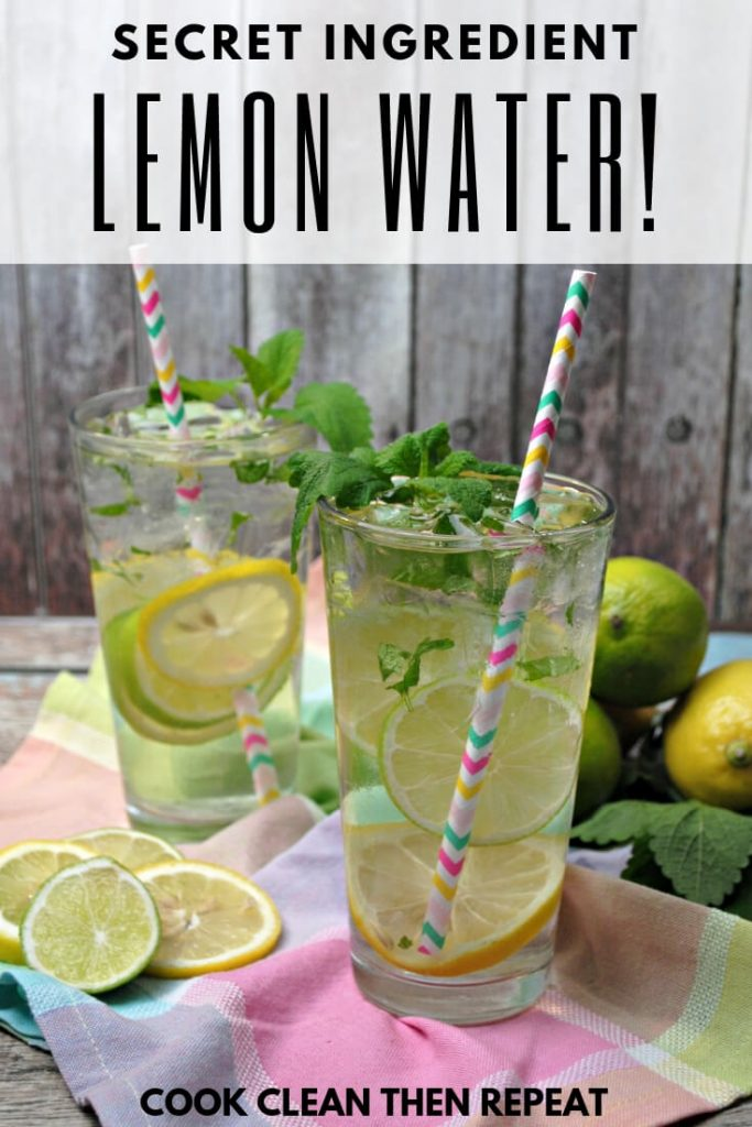 Secret Ingredient Lemon Water! At the top of photo of two glasses of water with lemon, leaves, limes, and paper straws.