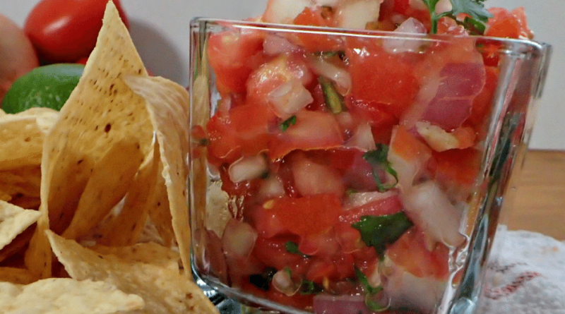 pico in a square glass dish with chips next to it.