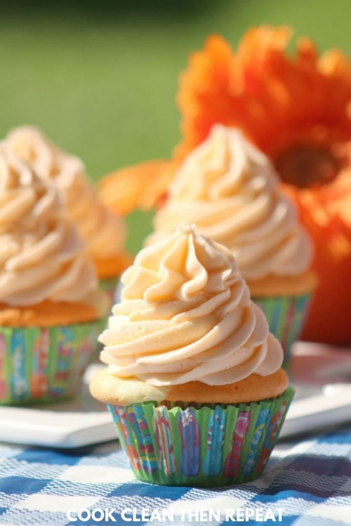 long image of finished cupcakes.