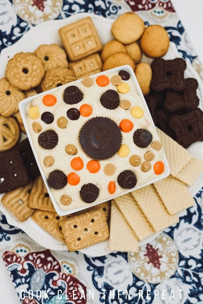 Tall image showing the finished dip on a plate of cookies.
