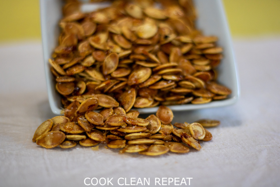 Featured image showing the finished maple roasted pumpkin seeds ready toe at.