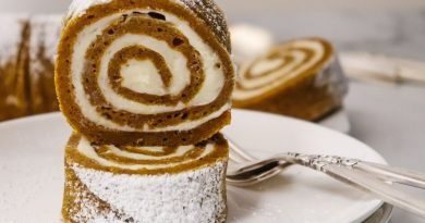 featured image of the pumpkin roll slices stacked on a plate to eat.