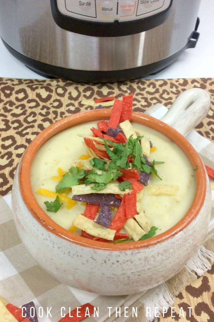 Finished cauliflower soup recipe in a bowl ready to be enjoyed.