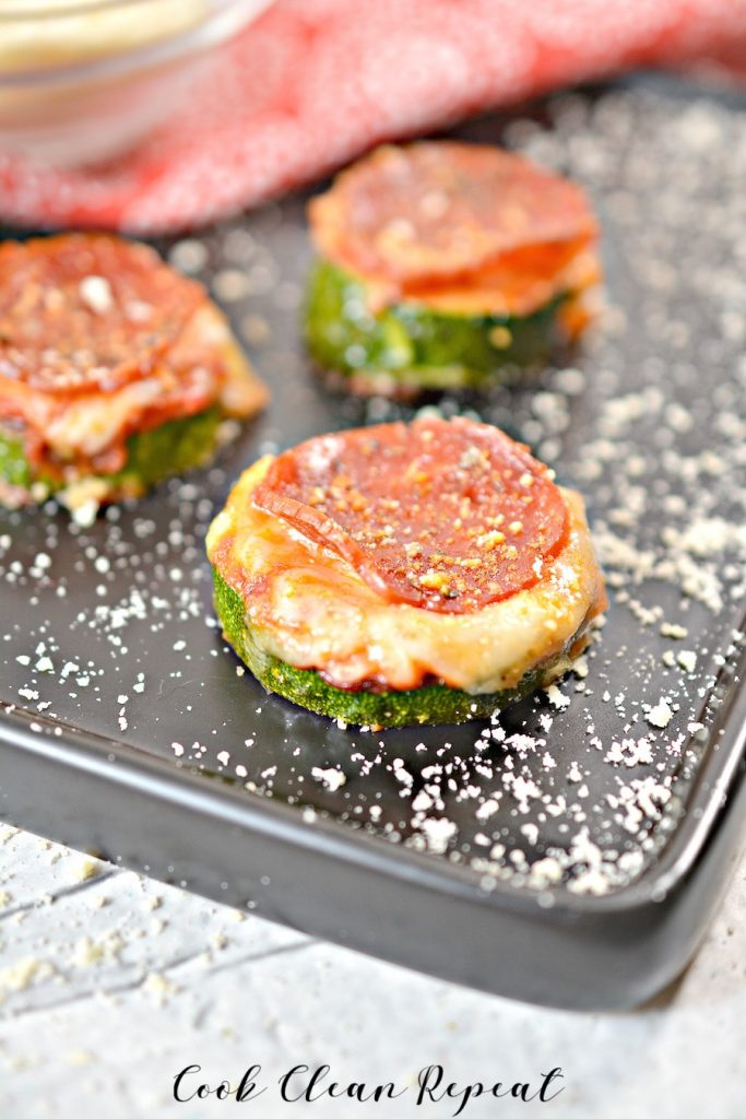 A shot of the finished zucchini pizza bites on a tray ready to eat.