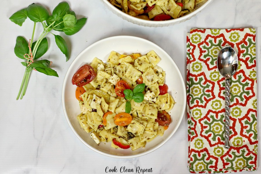 Pesto pasta salad with utensils ready to be enjoyed