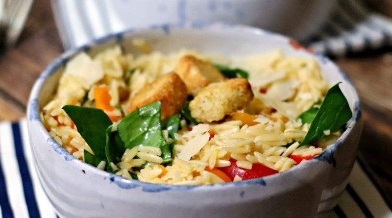 Featured Image showing the finished orzo pasta salad recipe in a bowl ready to eat.