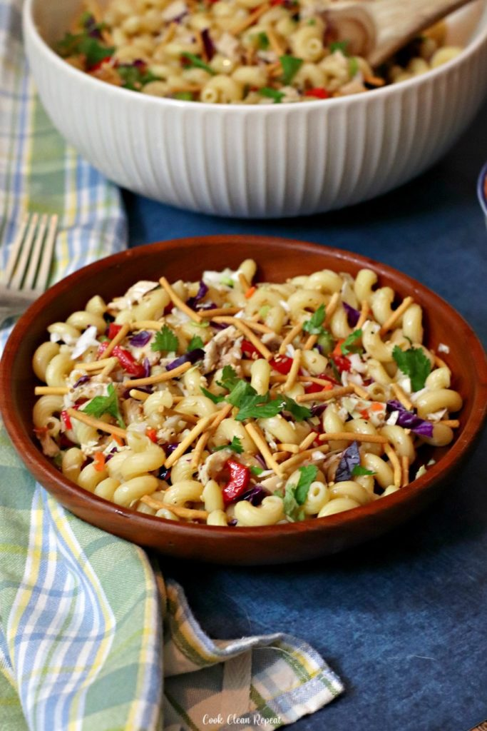 A full bowl of delicious pasta salad with chicken ready to be shared.