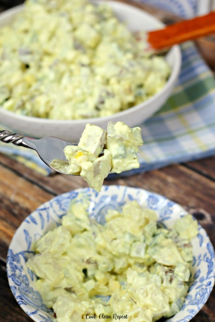a forkful of the delicious potato salad ready to be served.