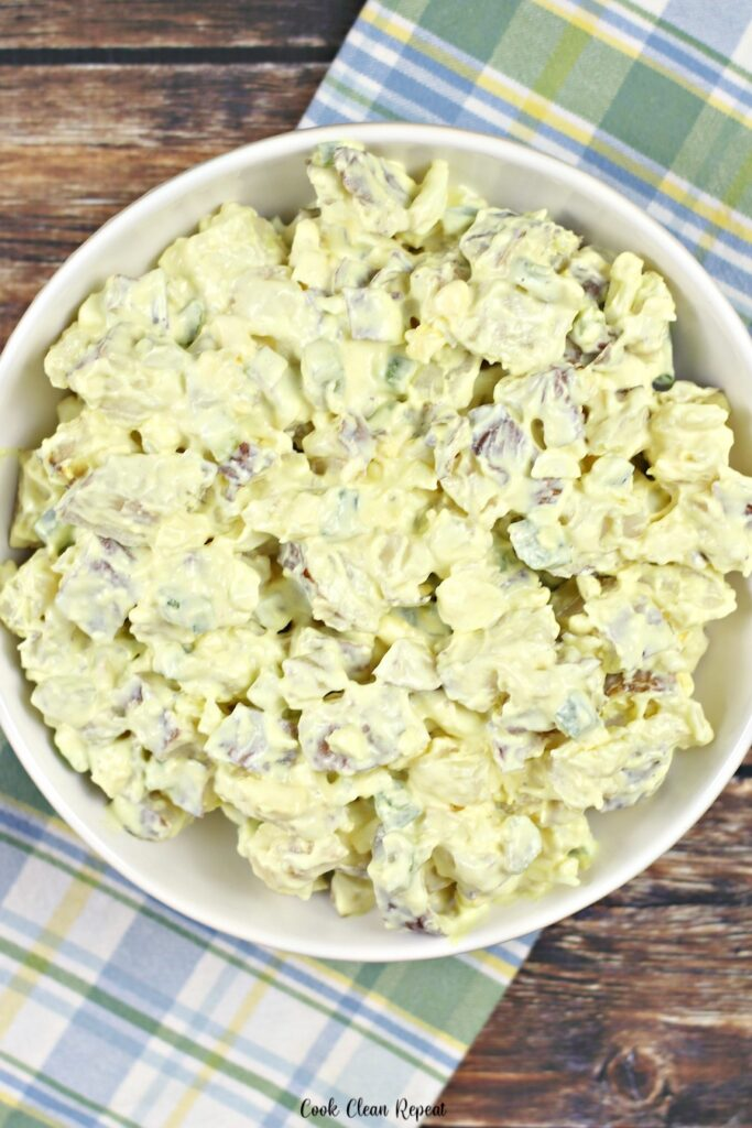 A top down view of the potato salad in a dish ready to be eaten.