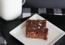This featured image shows the delicious brownies from scratch ready to eat with a glass of milk on the side.
