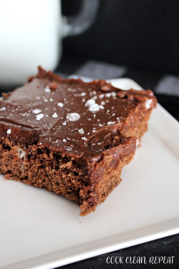 A close up of one of the finished homemade from scratch brownies on a plate.
