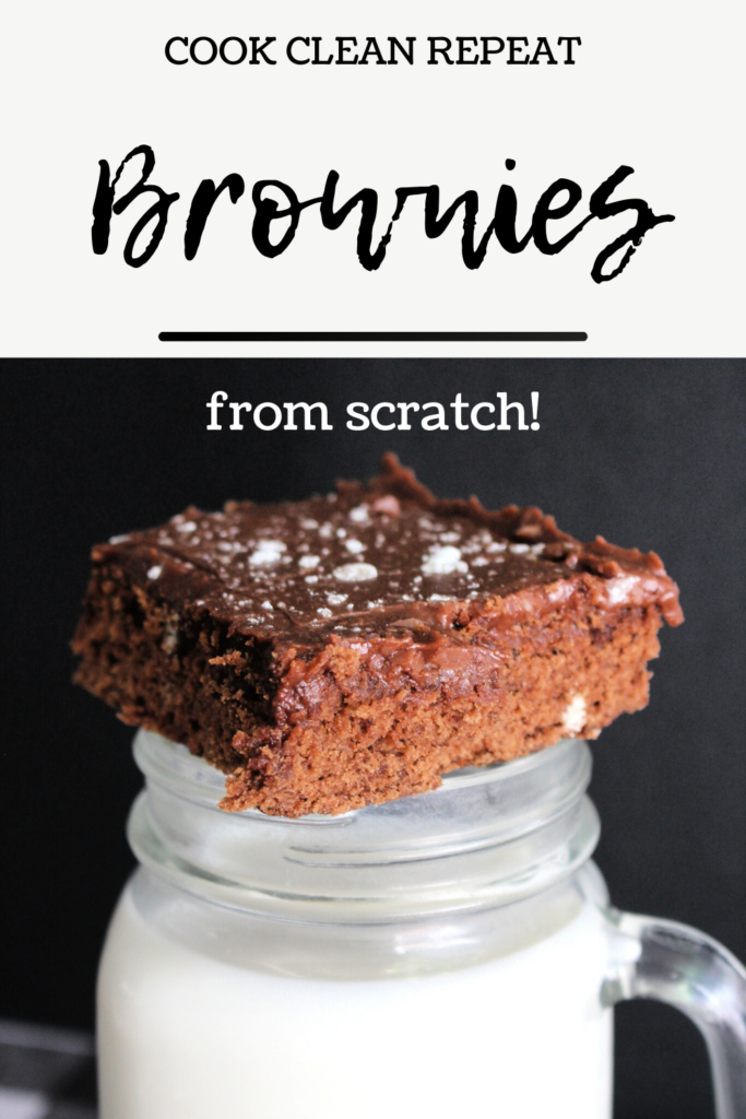 This is another pin that shows the finished brownies from scratch recipe on a glass of milk with the title across the top.