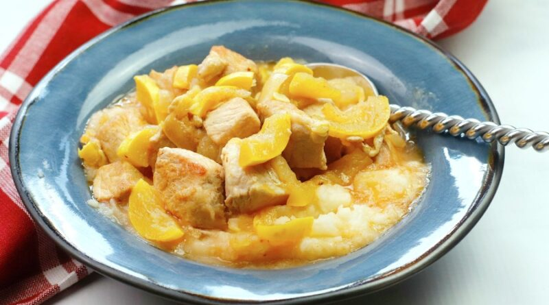 A featured image showing the finished pork and yellow squash skillet meal in a bowl ready to be eaten.