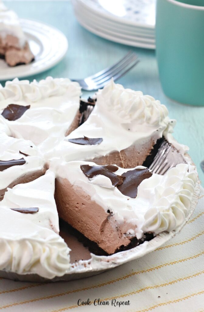 here we see the chocolate cheesecake pie with pudding cut and ready to be served on plates.