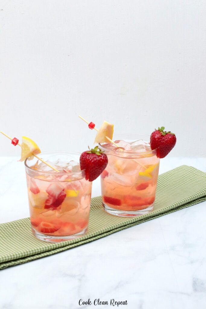Two glasses of strawberry lemon water ready to share.