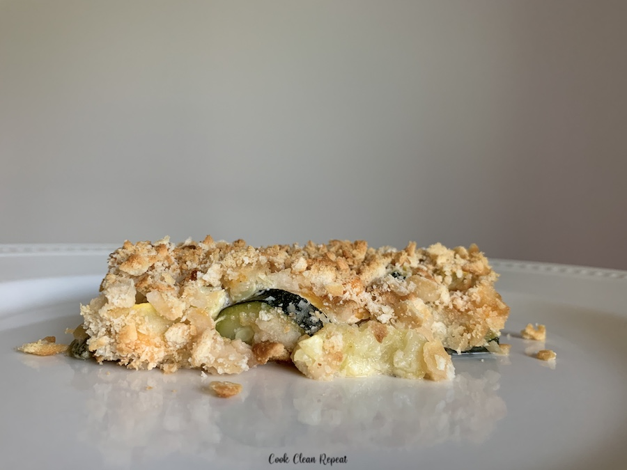 Featured image showing the finished zucchini and summer squash casserole on a plate ready to serve.