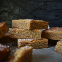 Featured image showing the finished stacked up peanut butter blondies ready to eat.