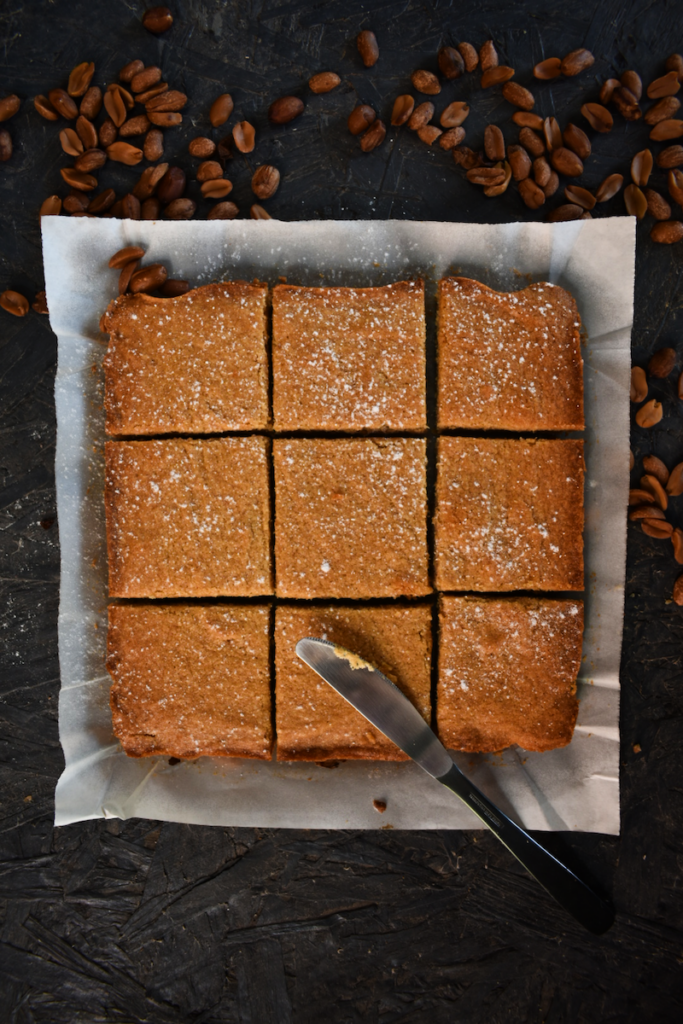 Featured image showing the finished and cut pan of peanut butter blondies.