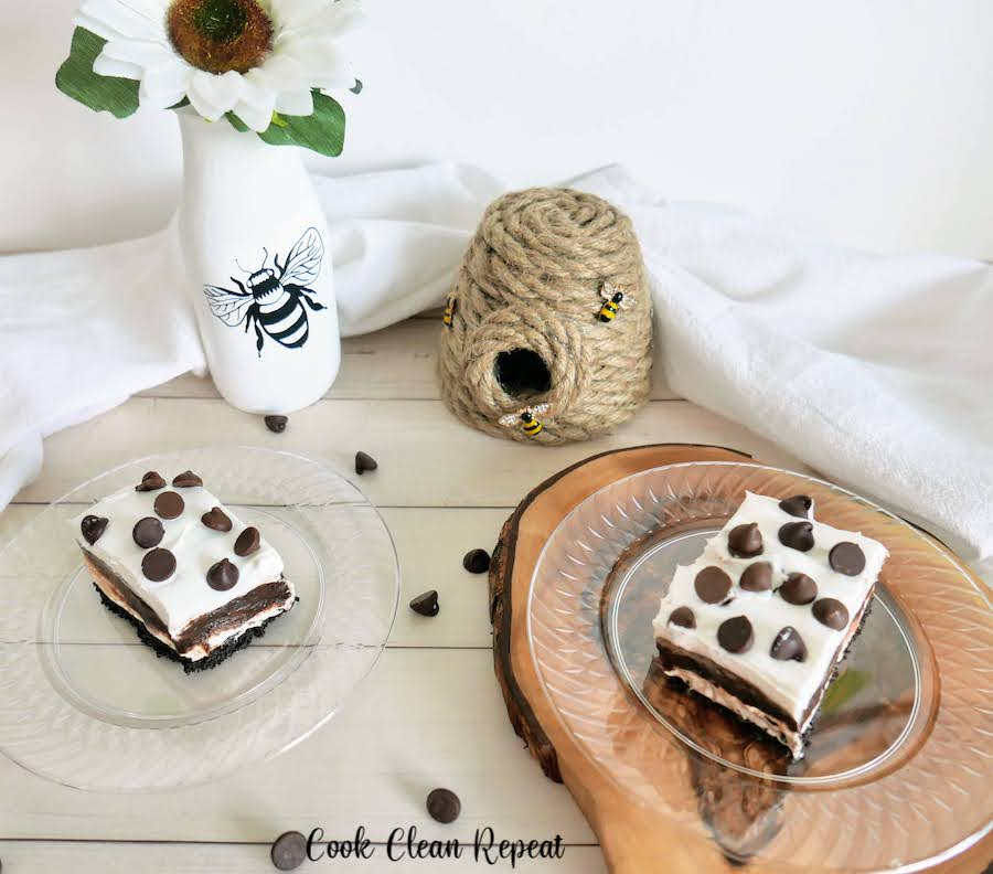 Featured image showing the finished no bake chocolate pudding dessert on plates ready to eat.