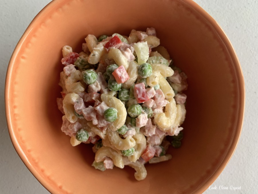 A bowl full of ham and pineapple pasta salad ready to be enjoyed.