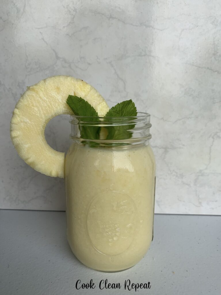The finished pineapple smoothie is ready to enjoy.