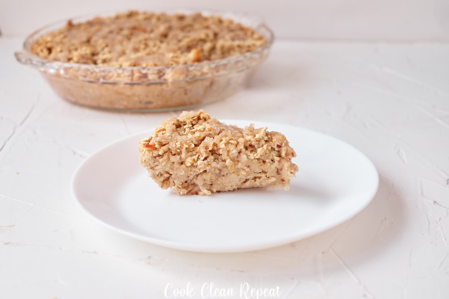 Featured image showing the finished baked apple oatmeal served on a plate ready to eat.