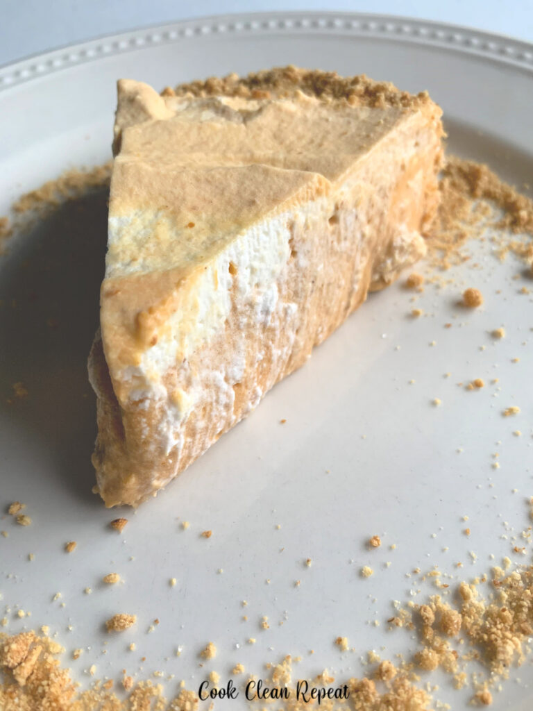 A slice of the finished pumpkin pie on a plate ready to eat.