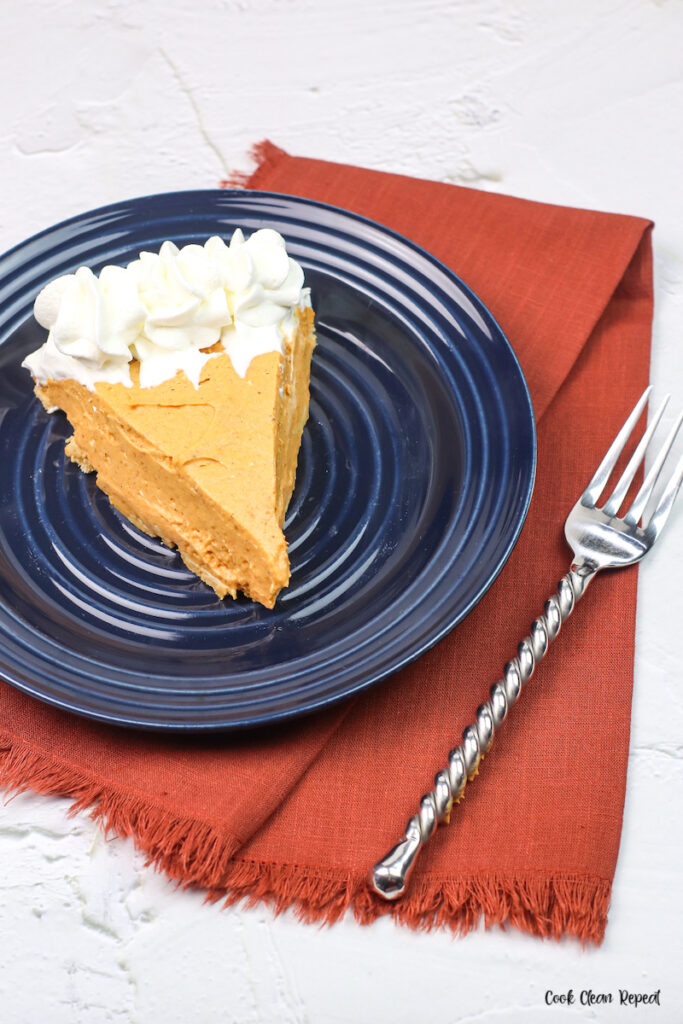 a piece of the finished no bake pumpkin pie ready to eat.