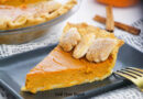 Featured image showing the finished baked pumpkin pie, a slice on a plate ready to eat.