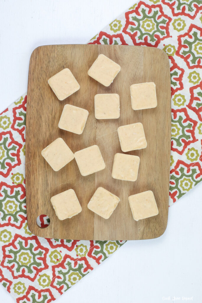 Cutting board with fudge laid out ready to eat.