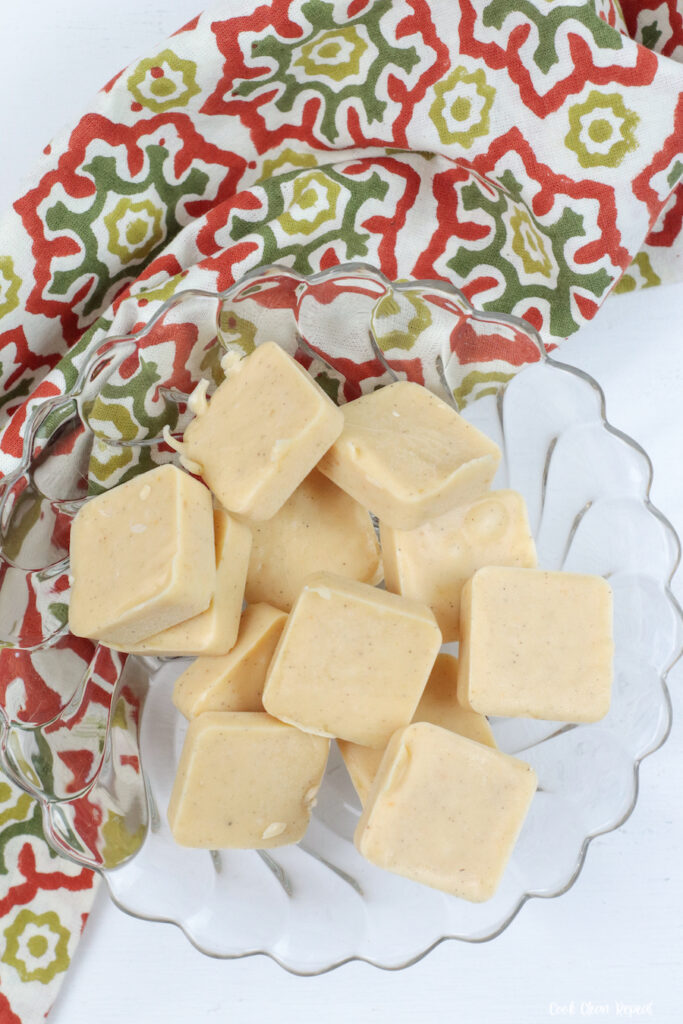 A bowl full of pumpkin fudge ready to be shared and enjoyed.