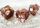 Here we see three pieces of the finished rocky road fudge ready to eat.