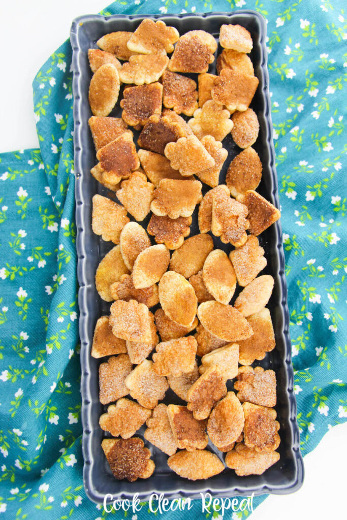 A top down look at the finished pie crust cookies on a tray ready to serve.