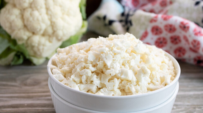 Featured image showing the finished product of how to make cauliflower rice ready to cook or store.