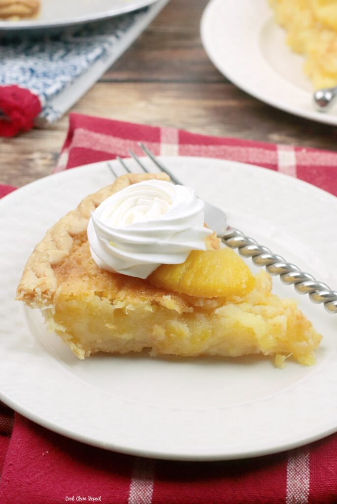 A look at a slice of the finished pineapple pie with whipped cream ready to eat.