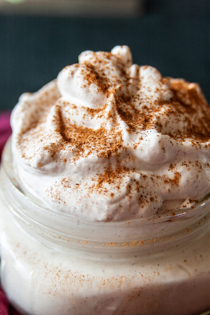 A close up of the finished and delicious looking cinnamon whipped cream topping.
