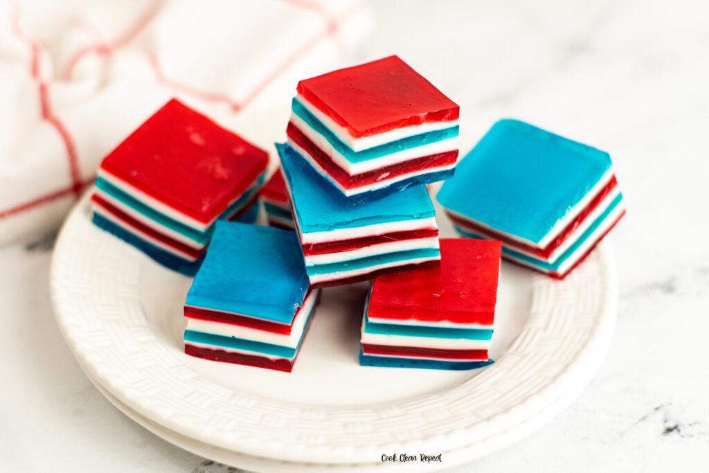 Featured image showing the finished red white and blue jello ribbon salad ready to eat.