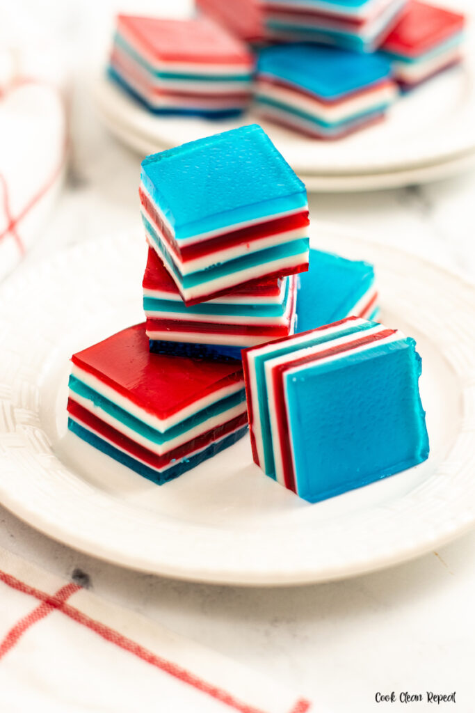 A stack of the finished red white and blue jello ribbon salad ready to eat.