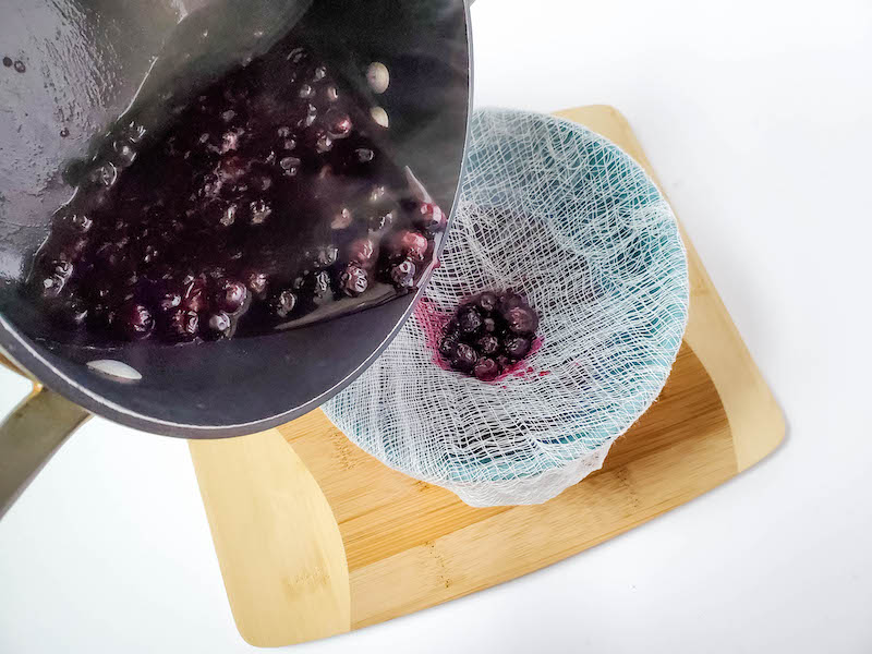 blueberries being strained.