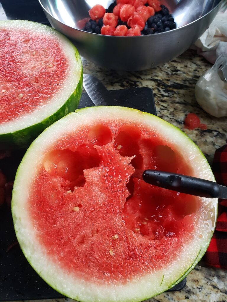 Watermelon sliced in half ready to be balled.
