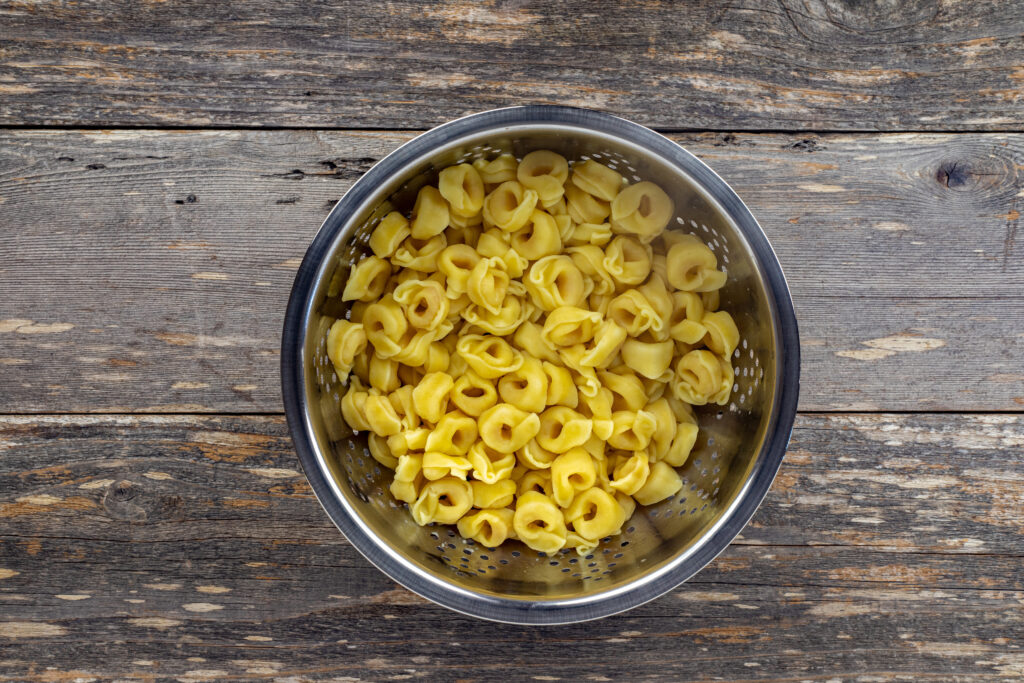 cooked tortellini ready to be mixed.