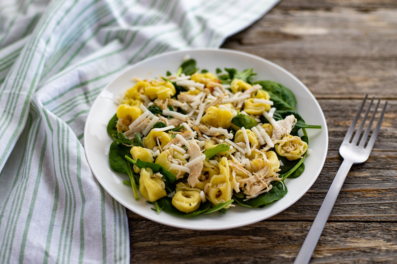 Featured image showing a bowl full of the finished lemon chicken tortellini salad ready to eat.