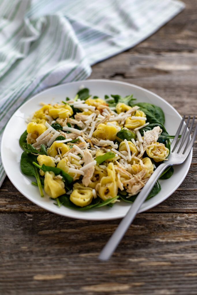 A bowl of the finished chicken tortellini salad ready to eat.