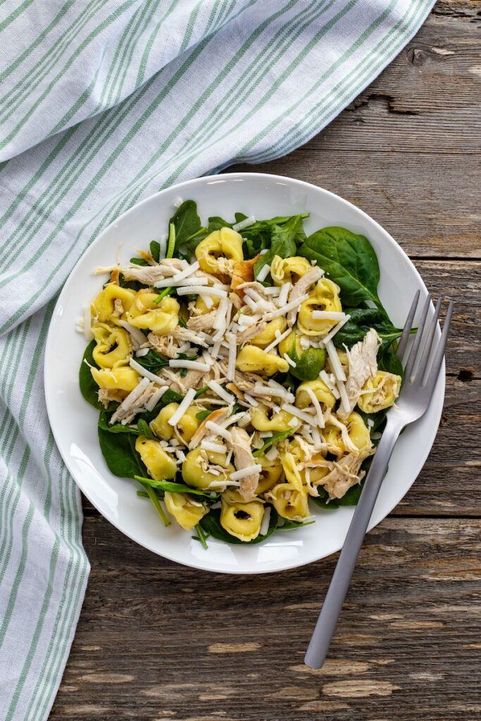 A close up of the finished lemon chicken tortellini salad ready to serve.