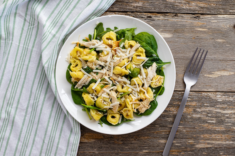 A top down look at the finished tortellini salad ready to eat.