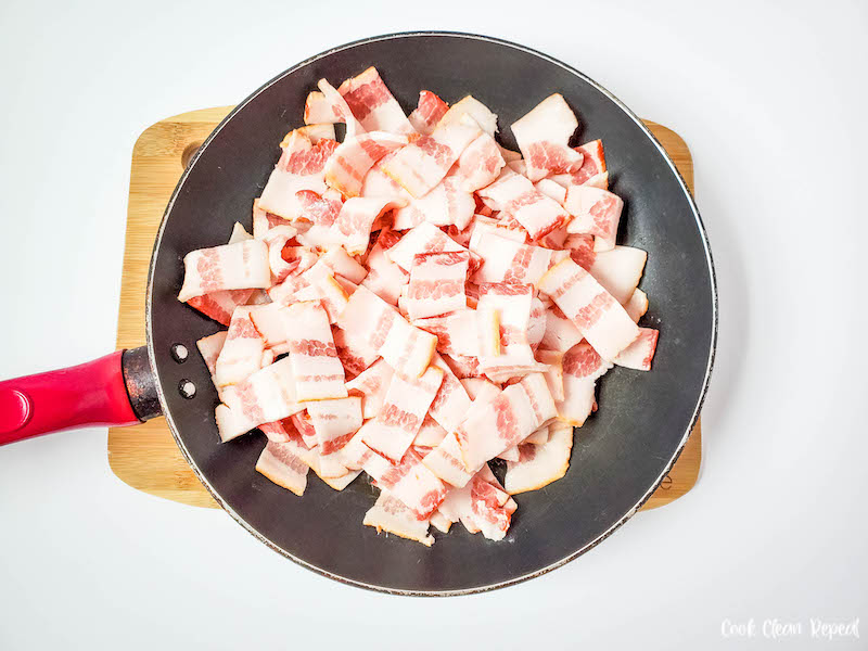 Bacon in a skillet ready to cook.