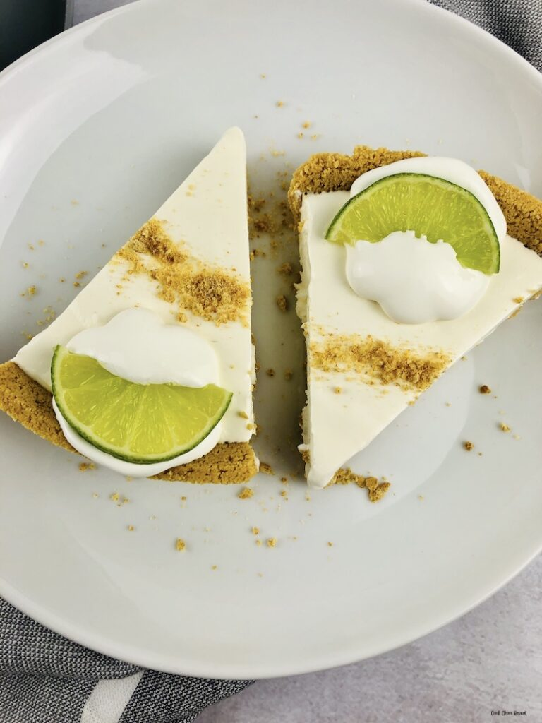 a close up of two slices of the finished key lime pie ready to eat.